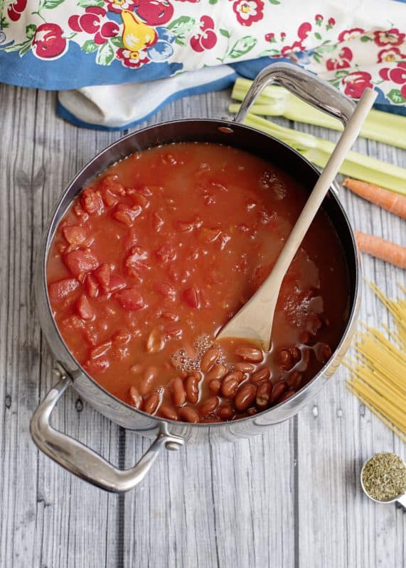 Adding beans to pot of Spaghetti Lover's Soup