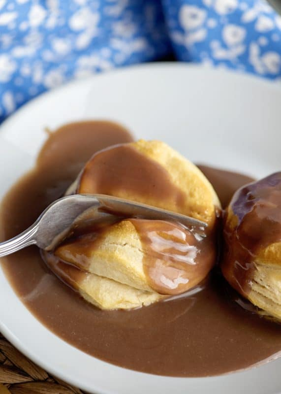 taking a bite with chocolate gravy
