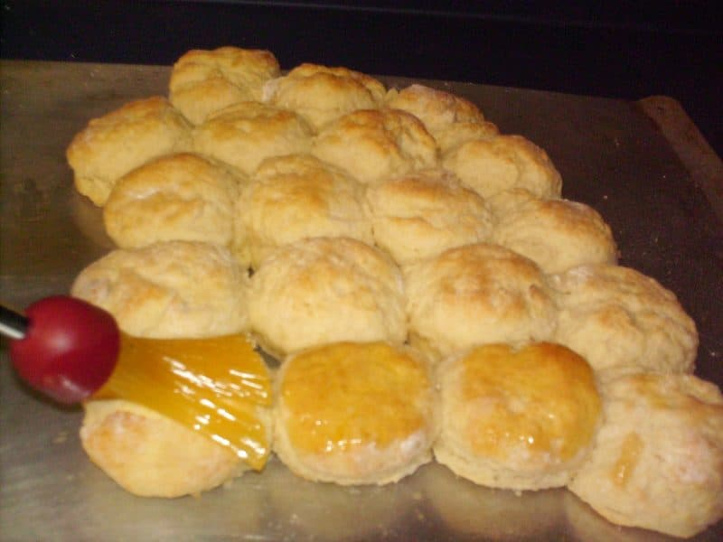 Brush melted butter on buttermilk biscuits