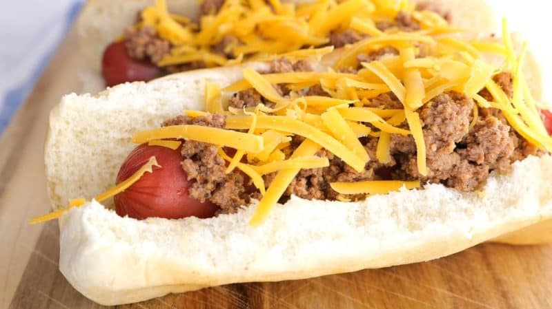 add your cheese to the hot dog and chili