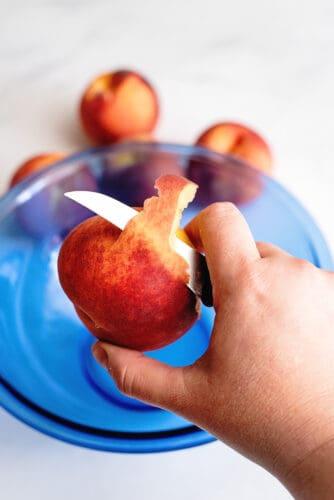 Peeling peaches.