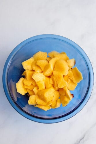 Chopped peaches in mixing bowl.