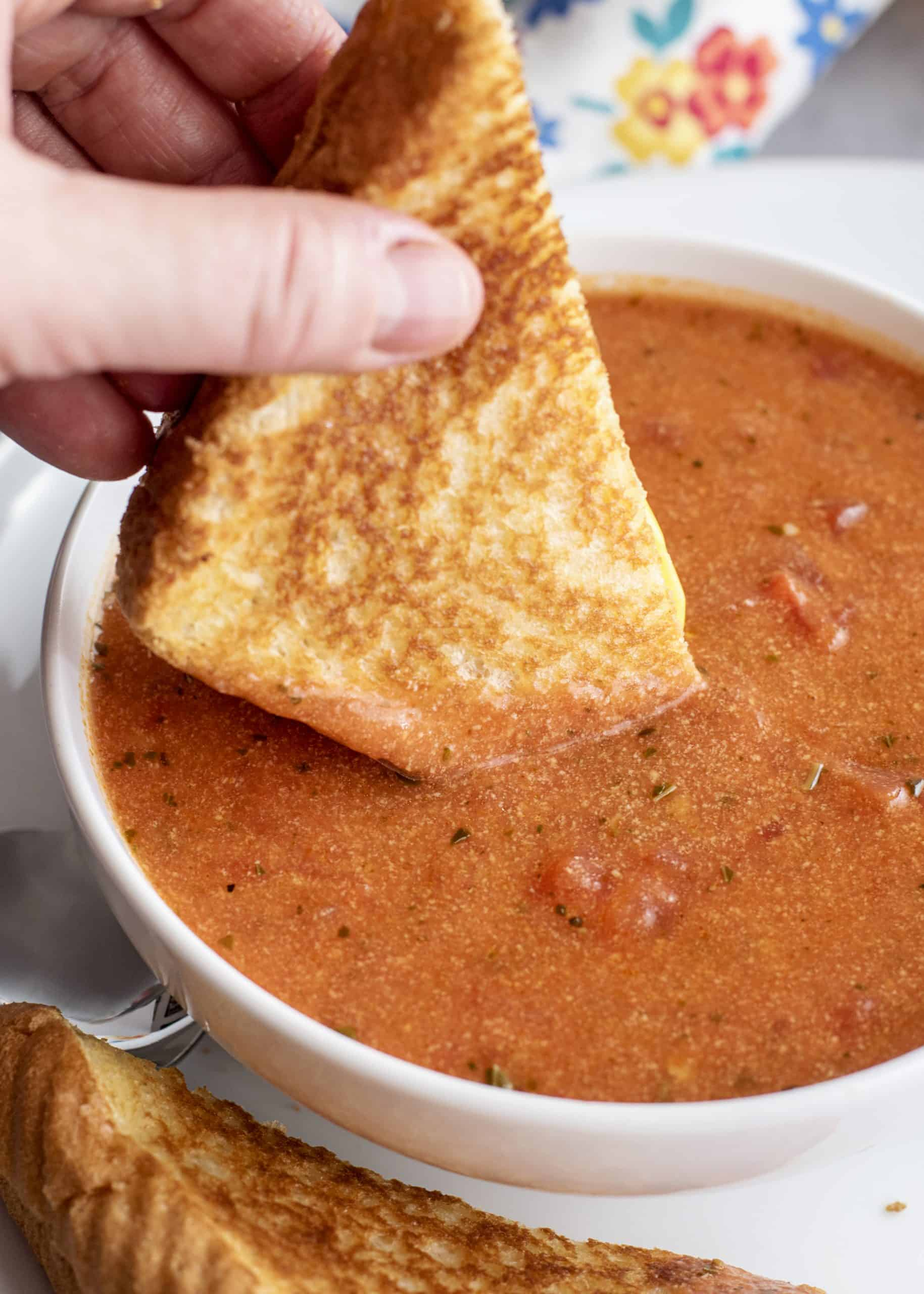 Dipping Grilled cheese into tomato soup