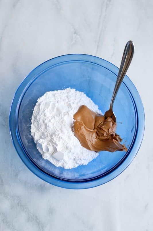 place confectionary sugar and peanut butter in a bowl
