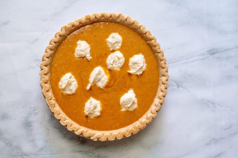 cream cheese dollops on pumpkin pie