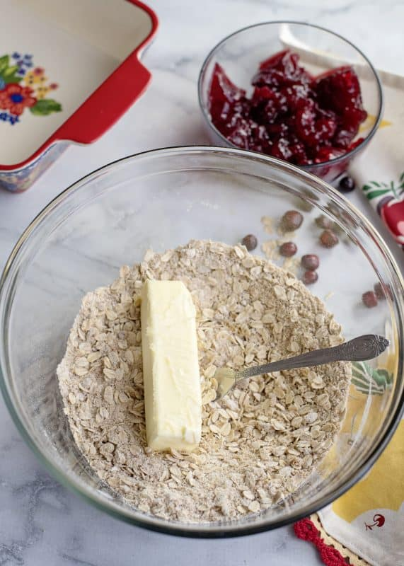 Adding butter to Cranberry Crunch mix