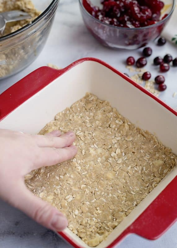 Patting crust in pan for Cranberry Crunch