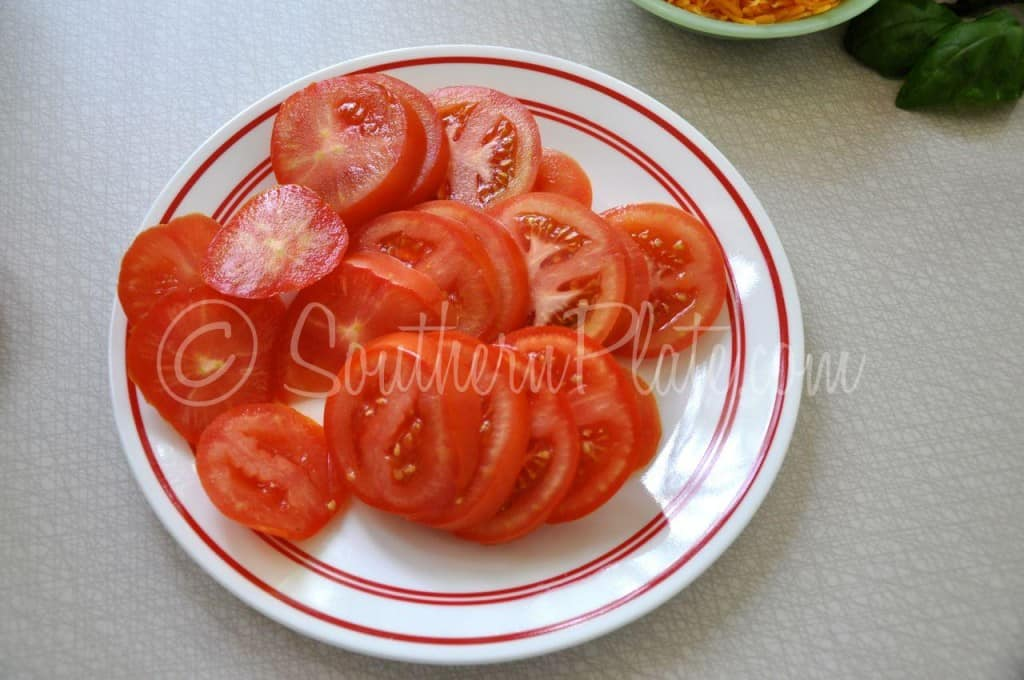 Plate of sliced tomatoes.