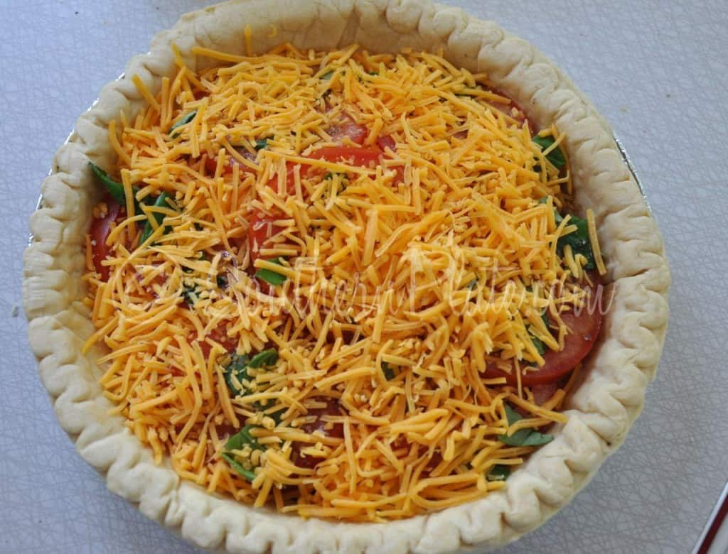 Cheese added to pie.