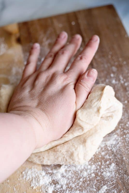 Knead the stuffed pizza crust dough for 3-5 minutes