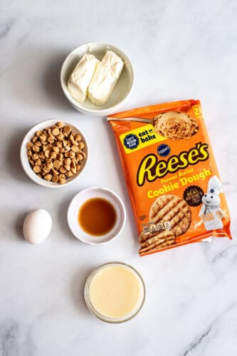 Ingredients needed to make peanut butter cheesecake cookie bars.