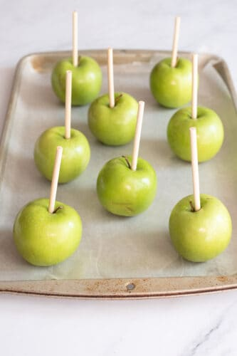 Stick placed in each apple.
