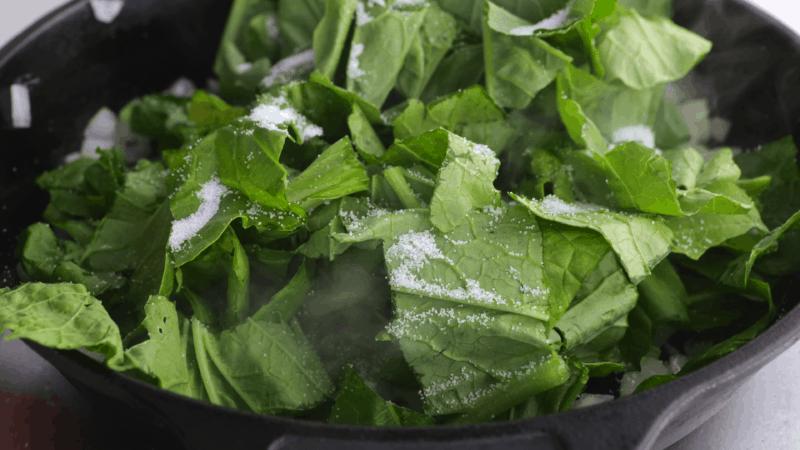 Add pinch of salt to greens.