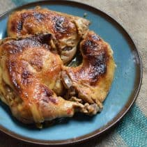 Dutch Oven Smokehouse Chicken - Slow cooked in a tenderizing sauce with a skin that crisps in the final steps, this chicken is amazing and made in your oven at home!