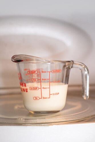 Heating milk in microwave.