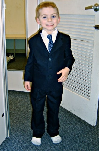 Brady trying on a new suit.  Age 6.