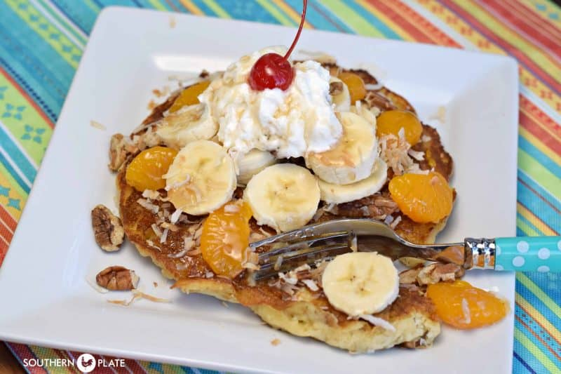 Paradise Pancakes ~ Hearty Oat Pancakes topped with toasted coconut, pecans, and fruit!