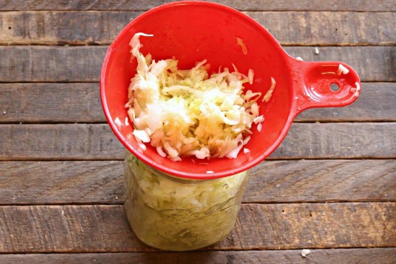 sauerkraut going in jar