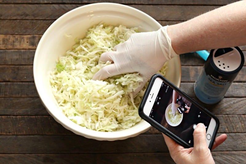 sauerkraut squeezing cabbage with phone