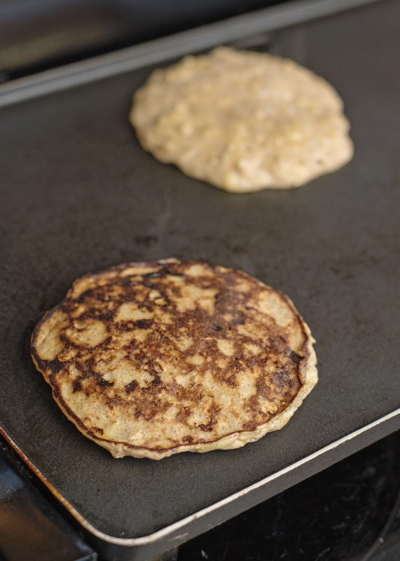 Banana Pancakes cooking on a griddle - Healthy, Quick, Simple, Delicious!