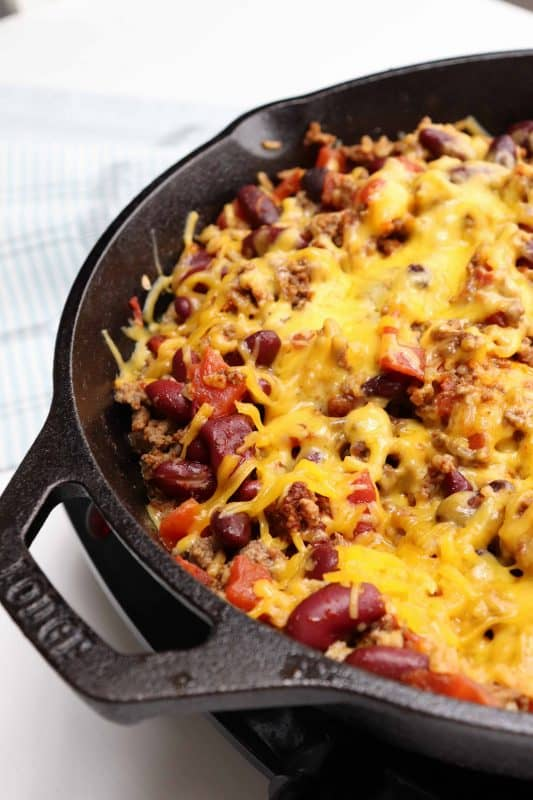 One Skillet Chili Bake topped with cheese