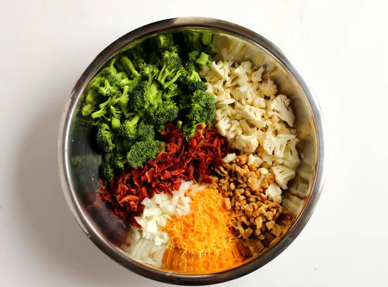 Ingredients in the bowl for Low Carb Broccoli Cauliflower Salad