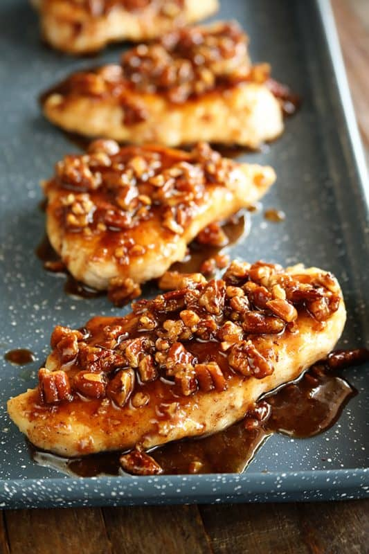 honey garlic pecan chicken breasts on a baking sheet