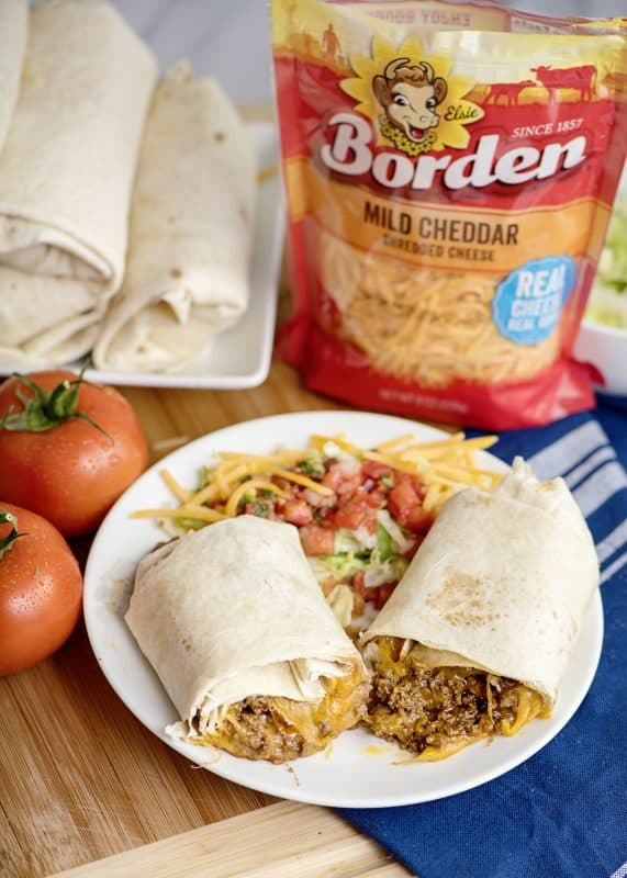 cheesy beef and bean burrito with tomatoes and cheese