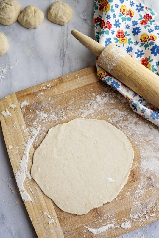 rolling out tortillas