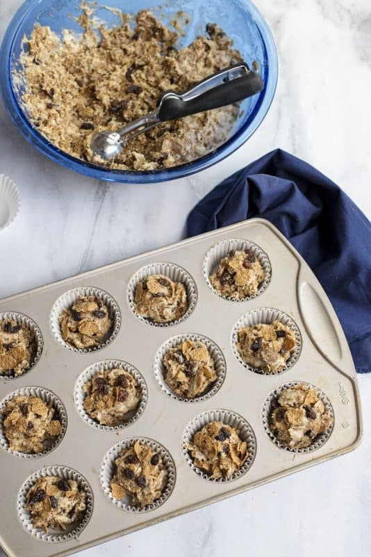 raisin bran muffins in pan ready to be baked