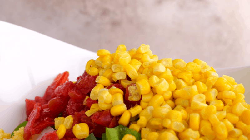 Veggies for cornbread salad in large bowl.
