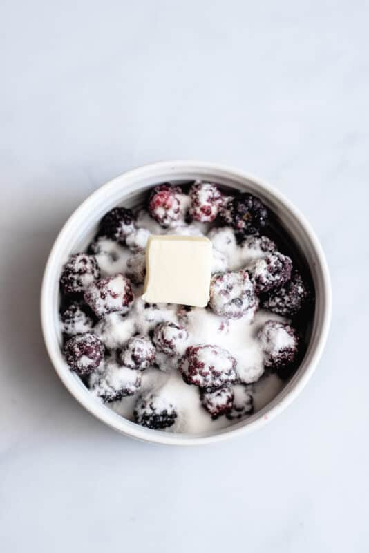 put berries in bowl with butterr