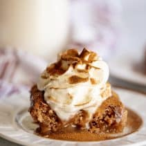 cinnamon cobbler topped with whipped cream