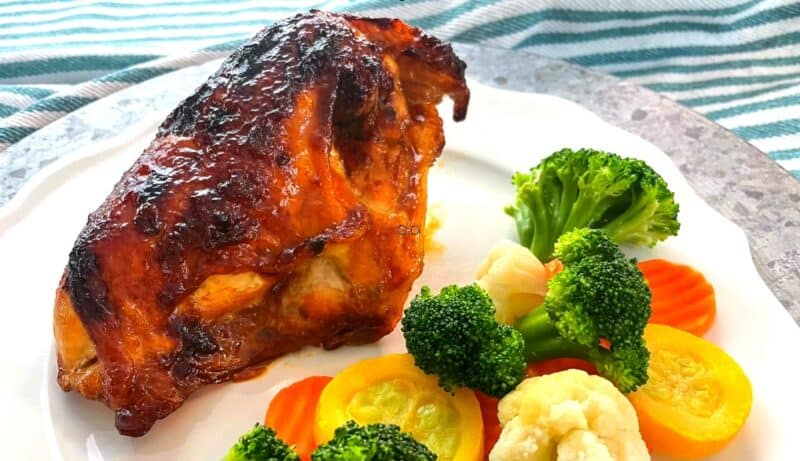 Sticky Chicken on plate with vegetables
