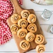 Sausage pinwheels on wooden board..