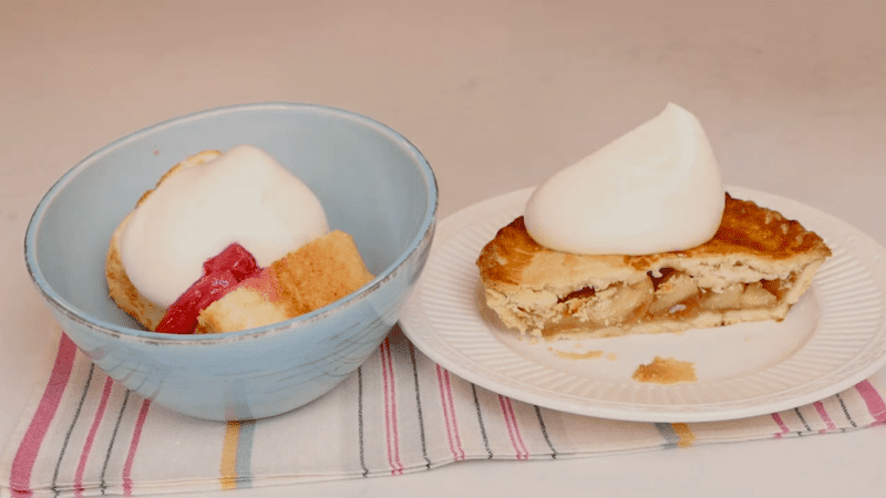 Pie topped with homemade whipped cream.