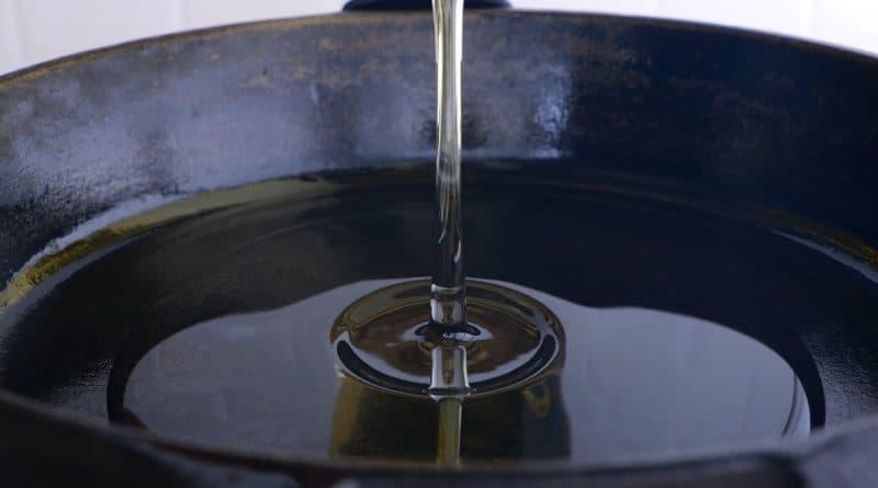 adding oil to pan.