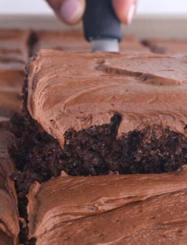 creamy chocolate frosting on a brownie slice.