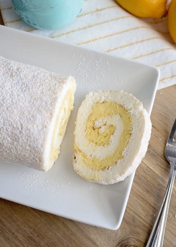 slice more of the lemon angel food cake roll for guests