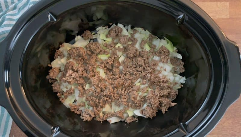 Layer in ground beef on top of cabbage and onion