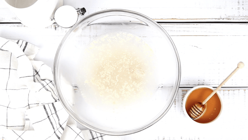 add water and yeast to bowl