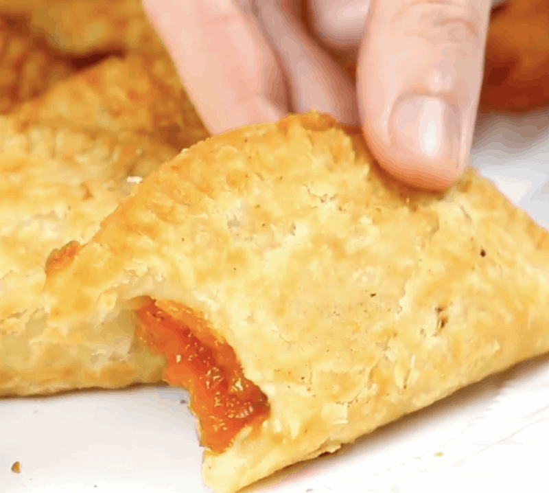 a bite out of a fried peach pie