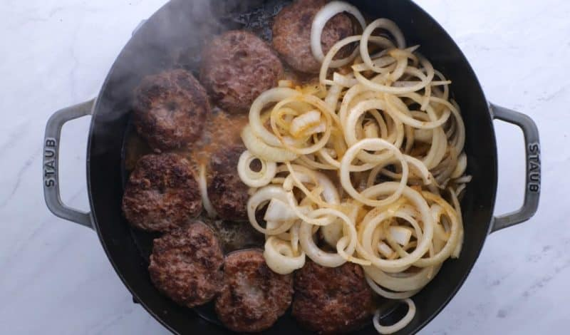 add beef broth to the hamburger steak and onions