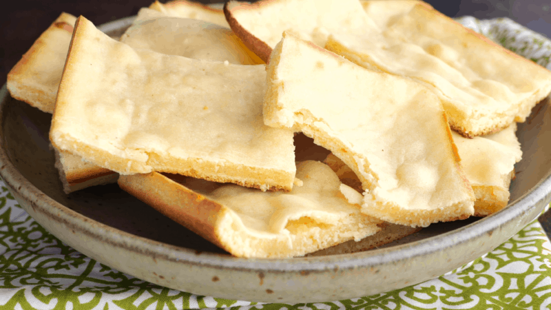 Soft unleavened bread pieces in bowl.