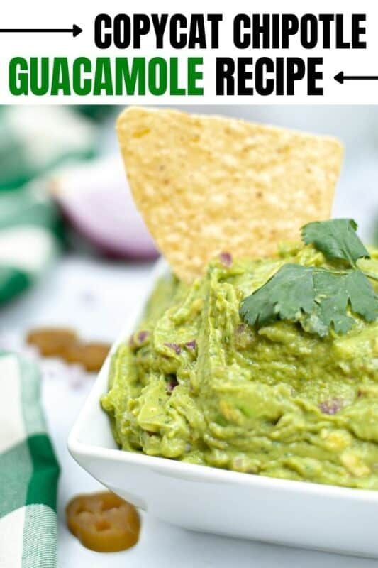 guacamole with chip in it on table
