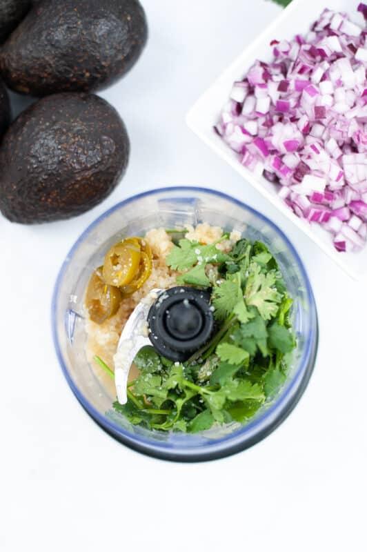 add in garlic, jalapeno, cilantro