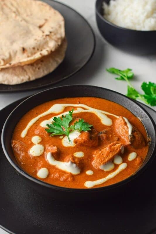 Indian butter chicken in a bowl on table