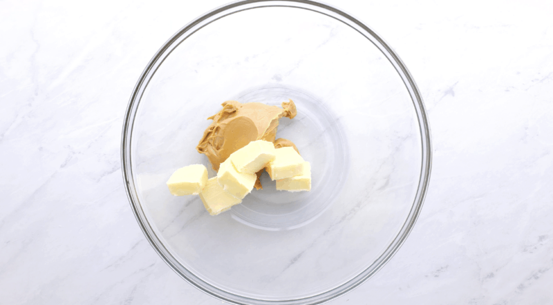 in a large bowl add peanut butter and butter