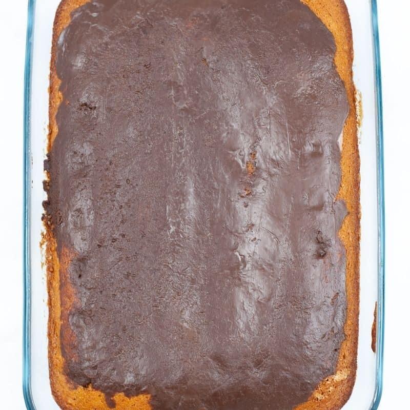 chocolate ganache spread all over a 9x13 cake pan