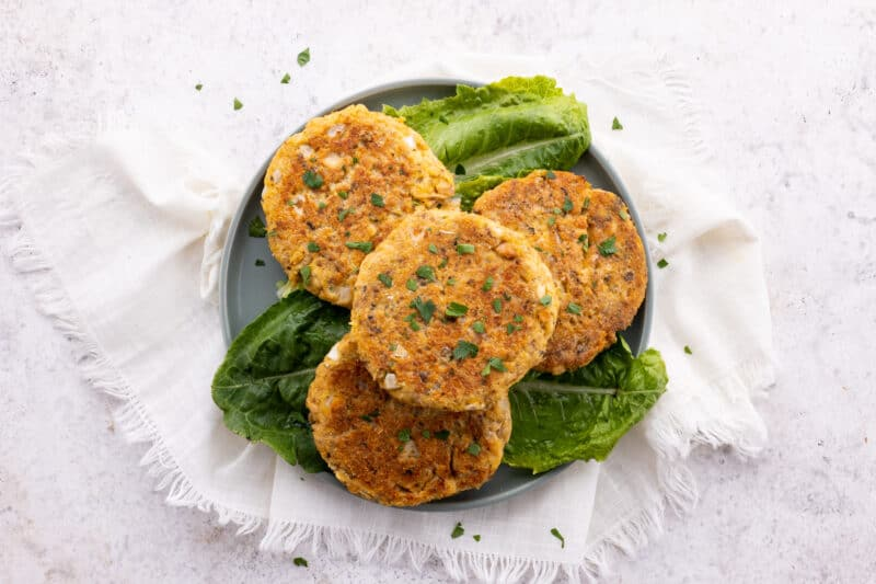 Stack of salmon patties on plate